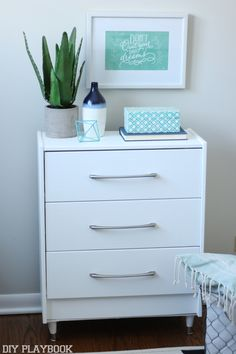 We transformed a $34 Ikea Rast dresser with new legs, some paint, and sleek metal handles.