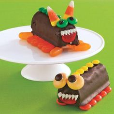 Easy Halloween crafts: Decorate chocolate snack cakes with icing and candy to turn them into Halloween Critters