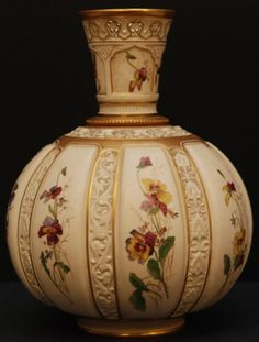 Antique Royal Worcester hand painted bulbous vase. It has beautiful scenes depicting flowewrs. Also has raised intricate figural scrolled leaf and flower design throughout. It's 11.5 inches in height