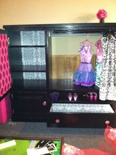 Alternate idea for dress up center using upcycled entertainment center. I love the mirror!