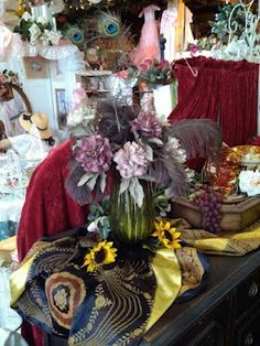 Feathers and flowers ... a blaze of color and texture.  Vendor 255 at the KC Armadillo    816 847 5260