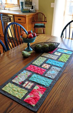 """Table runner with Fig Tree Fabrics, pattern is from """"On the run again"""" by…"""