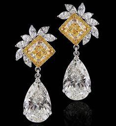 Kamyen Jewellery. 10 carat each pear shapes with fancy intense yellow cushions.