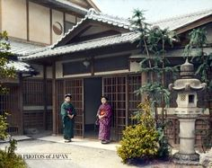 1924, Japan. Dwelling, Two Women Standing at Entrance. Two women in kimono stand at the entrance, called genkan (玄関), of a house of what appears to be a well-to-do family. There is a huge stone lantern and the large open area in front of the entrance suggests much space between the entrance and the gate.