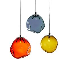-------Trixie----- Trixie is a dimpled hand blown sphere which can be arranged in clusters or as individual pendants with stainless steel cable.