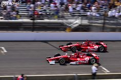 The Australian Scott Dixon (9) and team mate team mate Dario Franchitti (50) from Great Britain, both from the Target sponsored Chip Ganassi Racing, fight it out for 1st place in there Honda cars at the Indy 500, May 2012. Dario Franchitti went on to win the Indy 500 with Scott Dixon finishing 2nd.  © Copyright Philip Field 2012.
