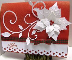 handmade Christmas card by GardenDiva ... red and white ... gorgeous white Spellbinders die cut poinsettia ...  flourish die cut leave ... circles border punch ... cute plaid bow ... beautiful card!!