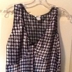 Old Navy Perfect Fit. Sleeveless Tank This tank is a 100% Polyester. Black lace surrounds the v neck and black ribbon is connected. There are 2 ties on the side of blouse to make a bow in the back.  Size is Medium. Colors are black, red and white. Old Navy Tops Crop Tops