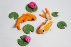 2 Handmade Miniature Koi with Lily Pads, Miniatures, Fairy Gardens. Miniature Landscapes, Miniature Koi Pond Made from polymer clay and sprayed with a Polymer Clay Fairy, Sculpey Clay, Cute Polymer Clay, Polymer Clay Animals, Cute Clay, Polymer Clay Miniatures, Polymer Clay Creations, Polymer Clay Crafts, Dollhouse Miniatures