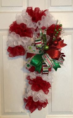 Handmade Christmas Deco Mesh Candy Cane Wreath With Ribbon Bow This handmade wreath is made with a candy cane wreath frame Merry Christmas, Handmade Christmas, Christmas Crafts, Christmas Decorations, Christmas Ornaments, Christmas Print, Christmas Time, Candy Cane Decorations, Christmas Door