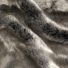 From Shannon Fabrics, this faux fur is truly better than the real thing! It's unbelievably silky soft, plush, and simply stunning. Perfect for coats, vests, accessories, throw blankets, pillows and toys. This faux fur has a very dense 30 mm pile of fine pearl fibers, which make it extra luxurious with a shimmer!