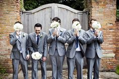 Groomsmen with cream buttonholes. Smart suits, fun picture