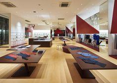 Tokujin Yoshioka installs red triangles at Issey Miyake store