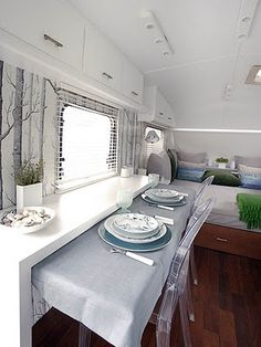 This camper is so neat and clean looking inside.  I could curl up in there all day with the windows open, reading a good book, preferably listening to the ocean somewhere.