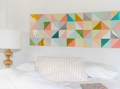 Geometric Patchwork Wall Art: We love the idea of artwork in place of a headboard, and this simple geometric paper idea is at the top of our list. (via The Red Thread Blog)