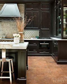 love dark cabinets.