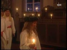 Sankta Lucia Sweden, Today, 12/13/2011, Sankta Lucia is celebrated in Sweden, Finland, Norway and Italy. Lucia brings light into the darkness in wintertime. Beautiful choir singing, Sankta Lucia and brining with them the light.