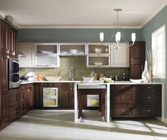 The contrasting wood tone of the Raisin mixed with the Earl Grey finish create a beautiful complementing palette in this interesting kitchen. Kitchen Cabinet Design, Kitchen Cupboards, Thomasville Cabinets, Rolling Island, Transitional Kitchen, Raisin, Kitchen Ideas, Cherry, Palette