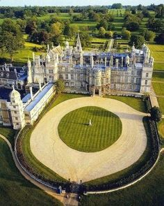 Burghley House is a grand Elizabethan country house in Cambridgeshire, UK miles km) south of Stamford, Lincolnshire, England. Its park was laid out by Lancelot 'Capability' Brown. Beautiful Castles, Beautiful Buildings, Beautiful Places, Palaces, Peterborough England, Photo Chateau, Mansion Homes, Vita Sackville West, English Manor
