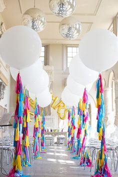 Balloon lovers must see this gallery!  You'll be amazed by how oversized latex with tassel streamers, large letter shapes, and unexpected arrangements (hint, a floating giraffe) created an unforgettable ambiance.  #weddings #balloons  Image by Faye Cornhill