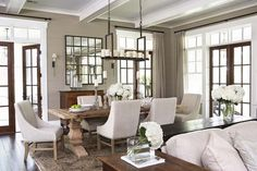 The paint color is Benjamin Moore Berkshire Beige AC-2 / Flat and the trim is Sherwin Williams Pure White SW7005 Satin. Palmetto Bluff - Private Residence - traditional - dining room - charleston - by Linda McDougald Design | Postcard from Paris Home