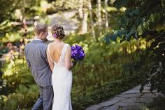 Perfect purple bouquet, cute couple, stunning surroundings. Check, check, and check! At the Arboretum | Bouquet by FestivitiesMN.com