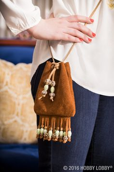 All you need for this totally stylish tote is a suede fringed bag kit and beads to embellish it with. Stylish Jewelry, Diy Jewelry, How To Make Purses, Cozy Scarf, Diy Purse, Fringe Bags, Acrylic Beads, Handmade Bags, Hobby Lobby