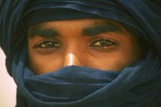 "Tuareg man. ""Imuhagh"" -- freemen. Specifically, Amajagh for men and Tamajaq for women, which only refers to the nobility. They are nomads, a Berber people, and have their own language. They go between borders, and usually reside in the Sahara and Saharan parts of Niger, Algeria, and Mali. However, to them, 'Sahara' can mean many deserts--Tinariwen (""the Deserts"")."