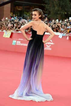 Lily Collins wearing runway dress - the back - on the Red Carpet at the Rome Film Festival. Oct. 2014