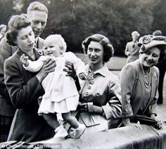 The picture featuring King George VI watching his granddaughter Princess Anne walking along a wall with her mother's support