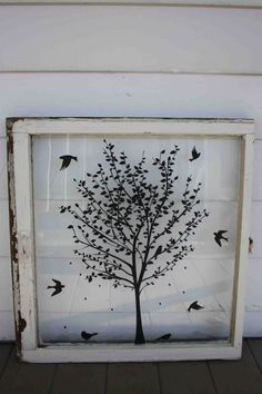 an old window w/ decals = wall art