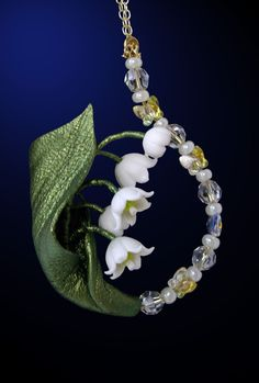 Lily of the valley - maybe take the beads around my ankle and the flower on the top of my foot
