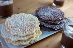 Super-easy recipe for dairy and egg free pizzelle cookies, in both chocolate and vanilla flavors. Vegan and nut free too.