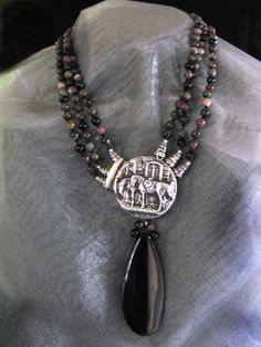 Tourmaline Horse Dream created by Lynn Parpard . One of a kind necklace Sterling Silver.