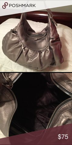 🌸REDUCED🌸 Cole Haan Leather Shoulder Bag Authentic Cole Haan leather shoulder bag pewter color with silver hardware. Dust bag included. Excellent used condition. Will consider all offers. Thank you. Cole Haan Bags Shoulder Bags