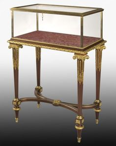 A Very Fine Museum Quality French 19th Century Louis XVI Style Mahogany and Gilt-Bronze Mounted Bijouterie Vitrine Table by Henri Dasson, with a glazed, hinged top and sides within a molded bronze frame