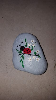 Ladybug on branch free hand painted rock
