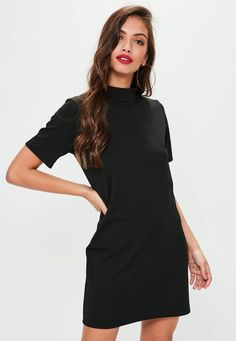 Black scuba dress with high neck, short sleeves and stretch fit.
