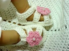 Crocheted baby sandals and blankets