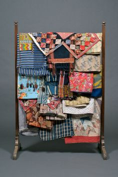 What a lovely rack of gorgeous textiles.