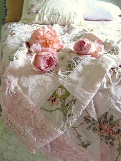 A lovely block looking quilt... pink rose floral with pale pink border with wonderful matching pink embroidery...