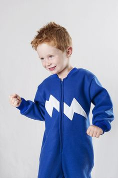 Blue onesies with GLOW in the DARK lightning bolt. Onesie + GLOW in the DARK = GLOWSIE = endless amount of fun for children.