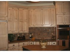 Refinished cabinets: Nantucket white with van dyke brown glaze on knotty alder cabinets - Refinished and Refaced Cabinets and Kitchens by Telisa