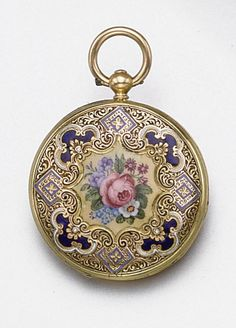 GOLD AND ENAMEL POCKET-WATCH/BRACELET, CIRCA 1840.  The hinged bracelet decorated in multi-colored enamel with a pattern of flowers and scrolls, the center accented with a spray of roses, pansies and forget-me-nots on a white enamel ground,  the hinged central compartment made to accommodate an 18 karat gold pocket watch, the case enameled in a matching floral design, the dial engraved with flowers and scrolls, featuring a black Roman numeral chapter ring and moon-style hands, key wind…
