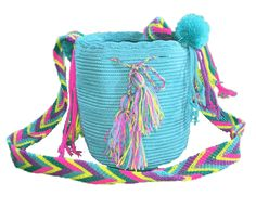 """Each PUTCHIPUU Bag is handmade by the women of the WAYUU Tribe located in the northern peninsula of Colombia in a rural area called La Guajira. Eachdesign is up to the women making the bag which makes each PUTCHIPUU bag unique and one of a kind. PUTCHIPUU bags are made of 100% Colombian cotton and because we care, we take the time to carefully scotchgard each and every bag twicebefore it arrives its final destination.  Approx. Measurements 6"""" H x 5"""" W Drop: 18.5"""" from shoulder to hip …"""