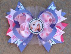DISNEY RAPUNZEL Princess Hair Bow Boutique Style Rapunzel Bottle Cap Bow with White Tulle Princes Ribbon. $9.49, via Etsy.