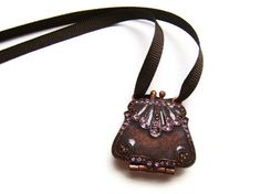 Upcycled Brown Purse Necklace, Rhinestone necklace, purse locket. ribbon necklace, vintage necklace. $20.00, via Etsy.
