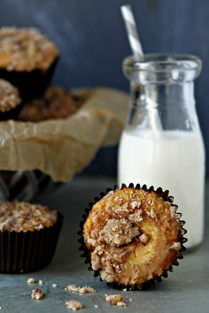 Delicious cream cheese filled pumpkin muffins finished with a sweet and spicy streusel topping.