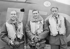 F/O Zdzisław Henneberg, F/L John A Kent and F/O Marian Pisarek (left to right) from No 303 Squadron RAF stand by Hurricane Mk I RF-U at RAF Leconfield on 24 October 1940. The aircraft was delivered fresh from the factory to RAF Northolt on 27 September and helped Pisarek gain ace status on 7 October when he destroyed an Me 109 over south London. It was one of the first Polish fighters to receive a sky spinner and fighter band in late November, following the AM edict issued on 27 November.