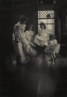 """This photo is simply entitled """"Dancing School"""" and was taken by influential early 20th century photographer Gertrude Käsebier. She was especially known for her eloquent images of motherhood, which can be seen in this 1905 photograph that may depict three young girls and their mother dancing. (Gertrude Käsebier/George Eastman House Collection/History By Zim)"""